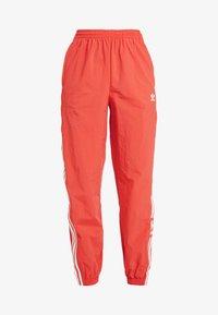 LOCK UP ADICOLOR NYLON TRACK PANTS - Teplákové kalhoty - trace scarlet/white