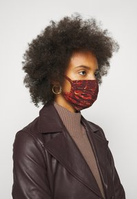 By Malene Birger - FACE MASK - Community mask - rustic brown - 1