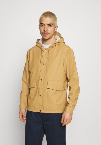 SHORT HOODED COAT UNISEX - Waterproof jacket - khaki