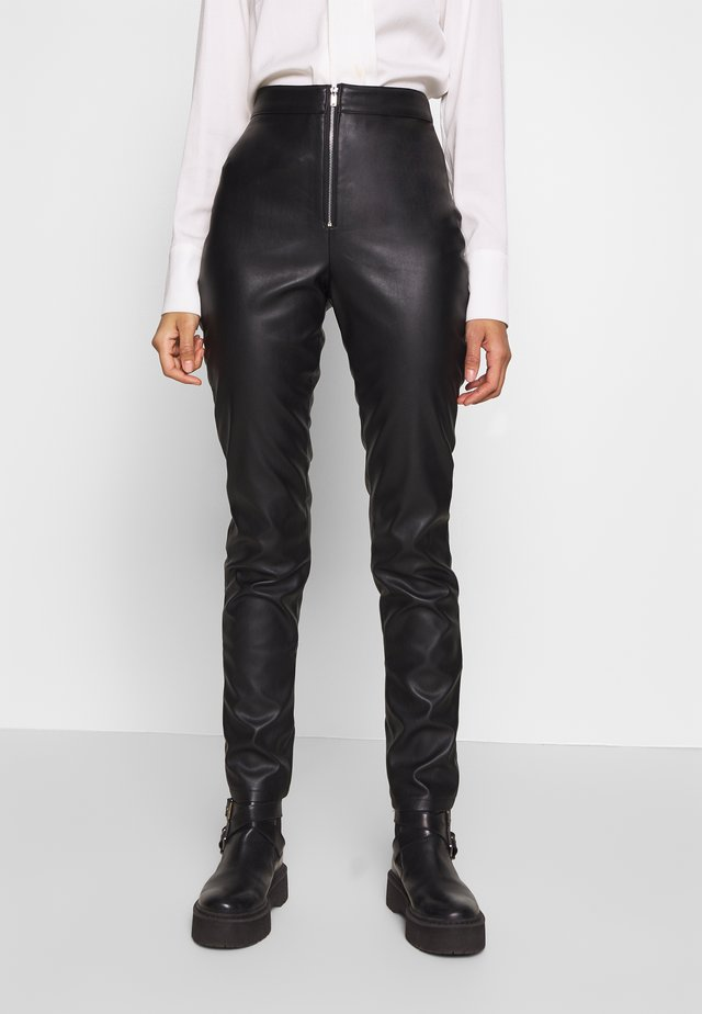 FAUX LEATHER TROUSERS - Leren broek - black