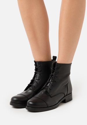 Lace-up ankle boots - alaska