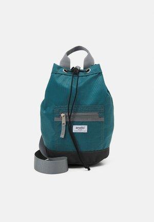 EPOCH CROSS BODY BAG UNISEX - Batoh - blue