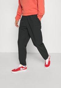 Nike Sportswear - Trousers - black - 0