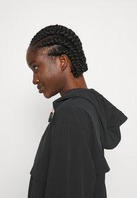 Nike Performance - RUN - Sports jacket - black/bright crimson - 5