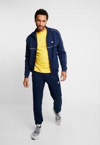 adidas Originals - TREFOIL PANT UNISEX - Tracksuit bottoms - collegiate navy - 1