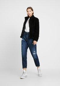 Vero Moda - VMVIRIGINIATEDDY HIGH NECK - Winter jacket - black - 1