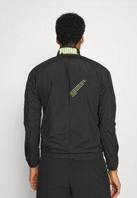 Puma - TRAIN FIRST MILE XTREME JACKET - Training jacket - black - 2