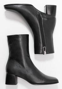 Filippa K - EILEEN BOOT - Kotníkové boty - black - 3