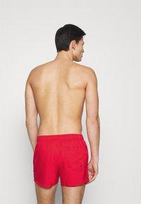 Puma - SWIM MEN SHORT LENGTH  - Swimming shorts - red - 1