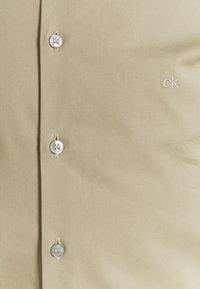 Calvin Klein Tailored - LOGO STRETCH EXTRA SLIM - Formal shirt - beige - 2