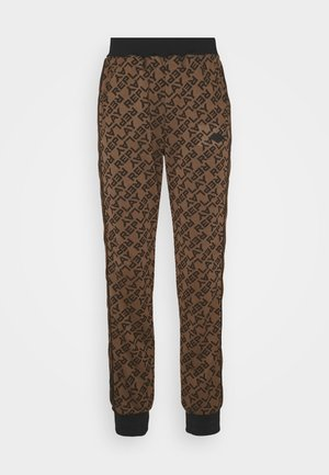 TROUSERS - Tracksuit bottoms - brown/black