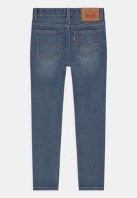 Levi's® - SKINNY TAPER - Jeans Skinny Fit - dark blue denim - 1