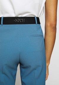 HUGO - HAMIRA - Trousers - dark blue - 4