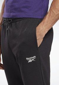 Reebok - SMALL LOGO ELEMENTS JOGGER PANTS - Tracksuit bottoms - black - 3