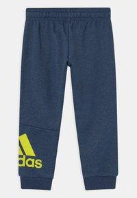 adidas Performance - UNISEX - Tracksuit bottoms - dark blue/neon yellow - 1