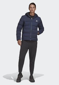 adidas Performance - HELIONIC SOFT HOODED DOWN JACKET - Down jacket - blue - 1
