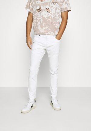 BIKER - Slim fit jeans - white denim