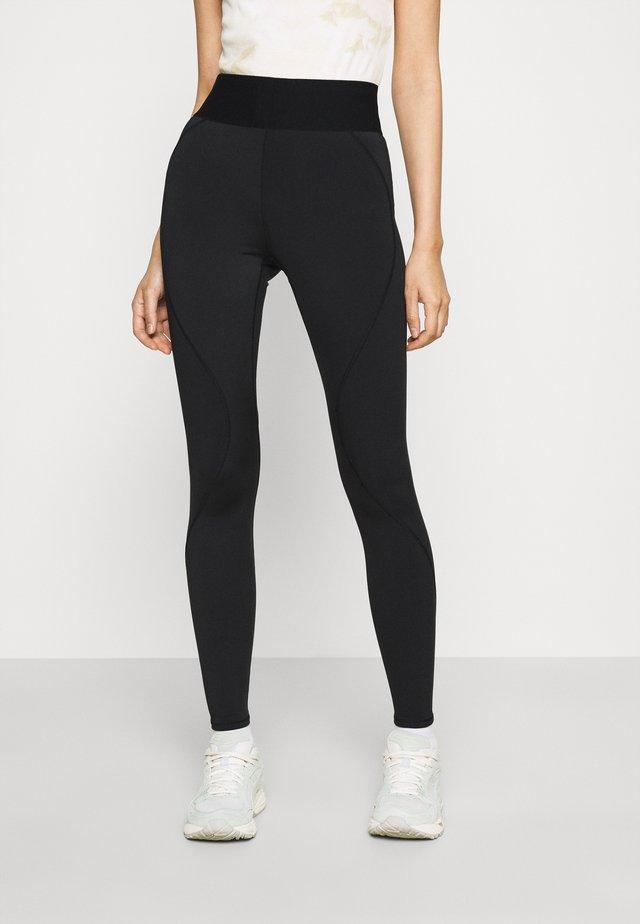 ACTIVE ESSENTIAL ICON  - Leggings - Trousers - black