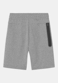 Nike Sportswear - Teplákové kalhoty - dark grey heather/black - 1