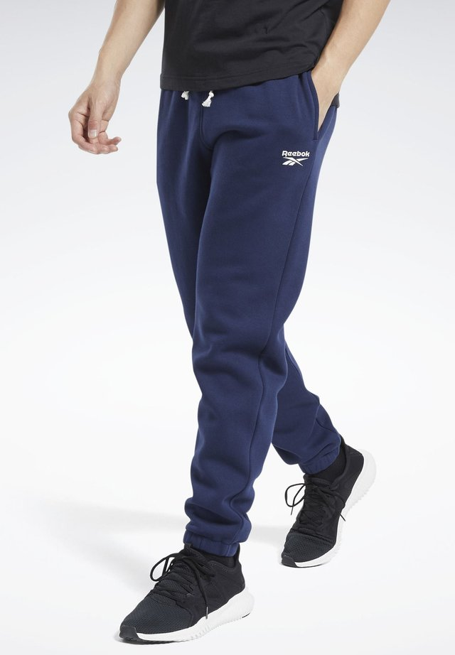 TRAINING ESSENTIALS CUFFED JOGGERS - Tracksuit bottoms - blue