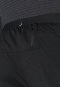 Nike Performance - ELITE PANT - Teplákové kalhoty - black/reflective silver - 5