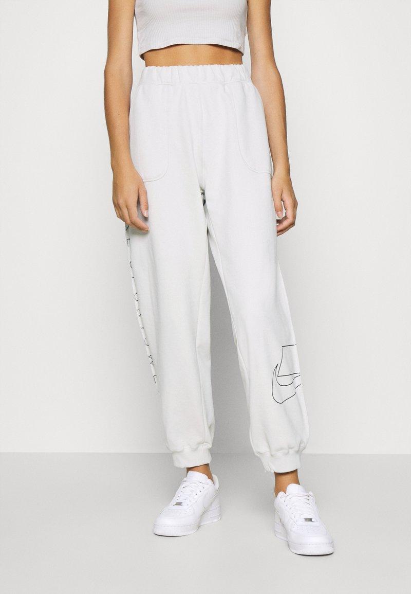 Nike Sportswear - Tracksuit bottoms - light bone