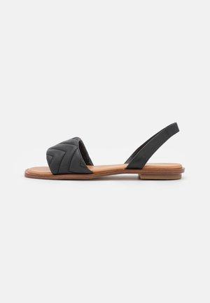 GRIRAWIAFLEX - Sandaalit nilkkaremmillä - black