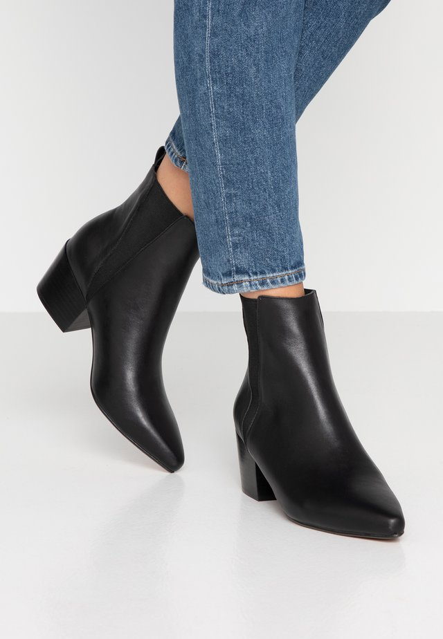 PUZZLE - Bottines - black