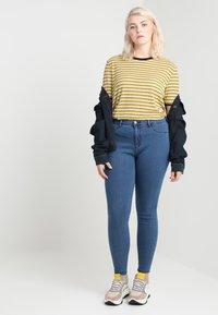 ONLY Carmakoma - CARSTORM - Jeans Skinny Fit - medium blue denim - 1
