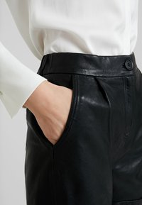 Cream - VICTORIA - Leather trousers - pitch black - 4