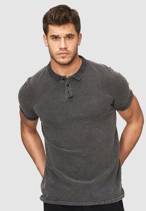 NATHAN - Polo shirt - black