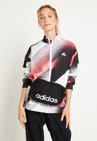 adidas Performance - ESSENTIALS LINEAR SPORT WAISTBAG - Bum bag - black/white - 1