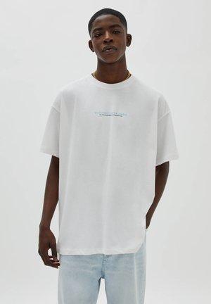 WILD STREETS STÄDTE - Print T-shirt - white