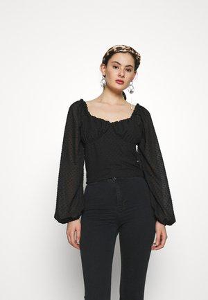 Donna Romina x NA-KD - Blouse - black