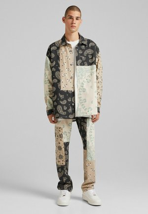 PAISLEY PATCHES - Jeans relaxed fit - beige