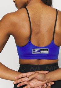Nike Performance - SISTERHOOD - Light support sports bra - hyper royal/black - 4