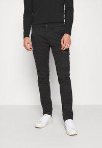 Napapijri - MOTO WINT - Cargo trousers - black - 0
