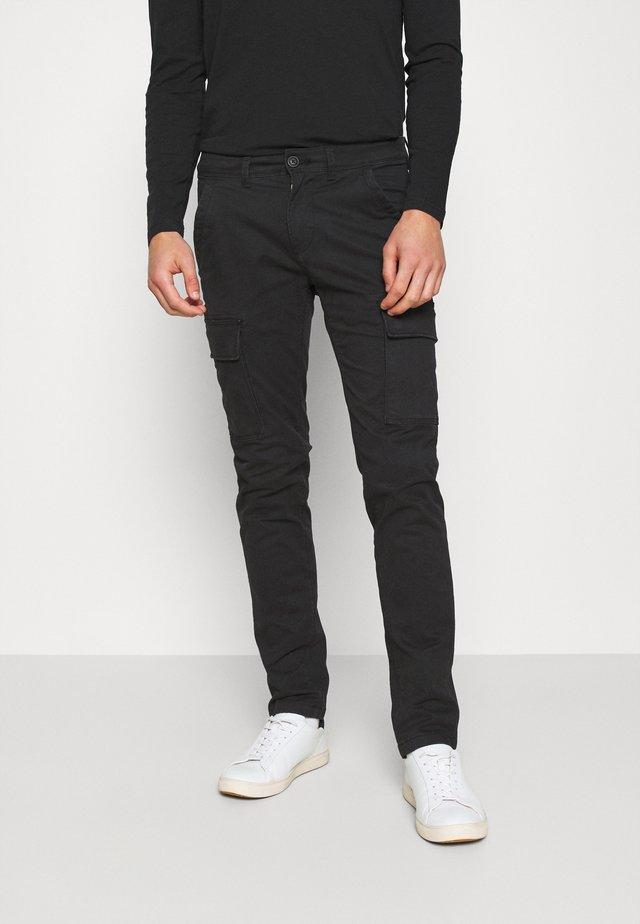 MOTO WINT - Cargo trousers - black