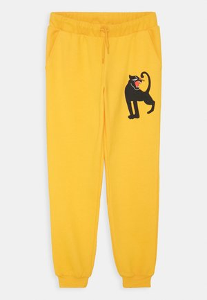 PANTHER UNISEX - Tracksuit bottoms - yellow