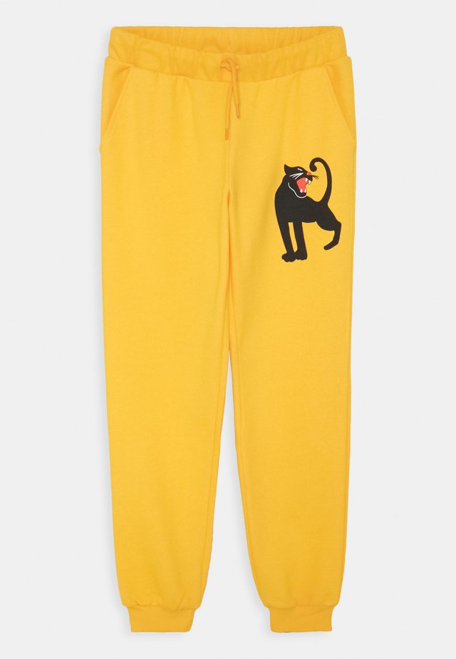PANTHER UNISEX - Pantalones deportivos - yellow