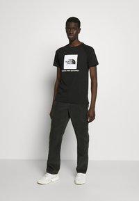 The North Face - RAGLAN TEE  - Print T-shirt - black/white - 1
