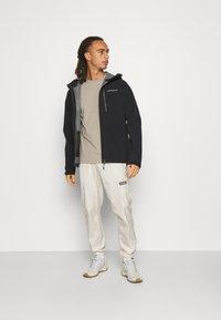 Peak Performance - XENON JACKET - Hardshell jacket - black - 1