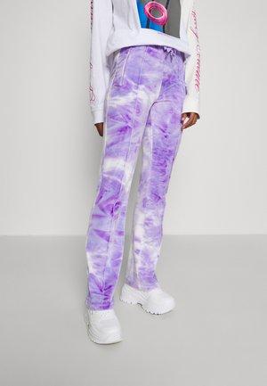 PRINTED TINA TRACK PANTS - Tracksuit bottoms - purple sea