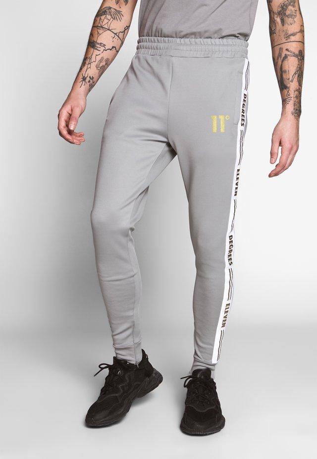 ASYMMETRIC TRACK PANTS - Spodnie treningowe - silver