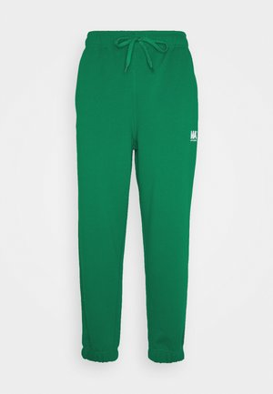 TRACKPANTS - Tracksuit bottoms - evergreen