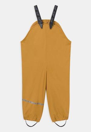 RAINPANTS SOLID UNISEX - Pantaloni impermeabili - mineral yellow