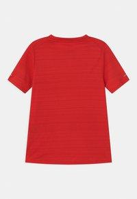 Nike Performance - MILER - Basic T-shirt - university red - 1