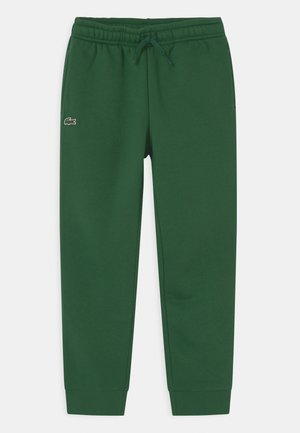 UNISEX - Tracksuit bottoms - green