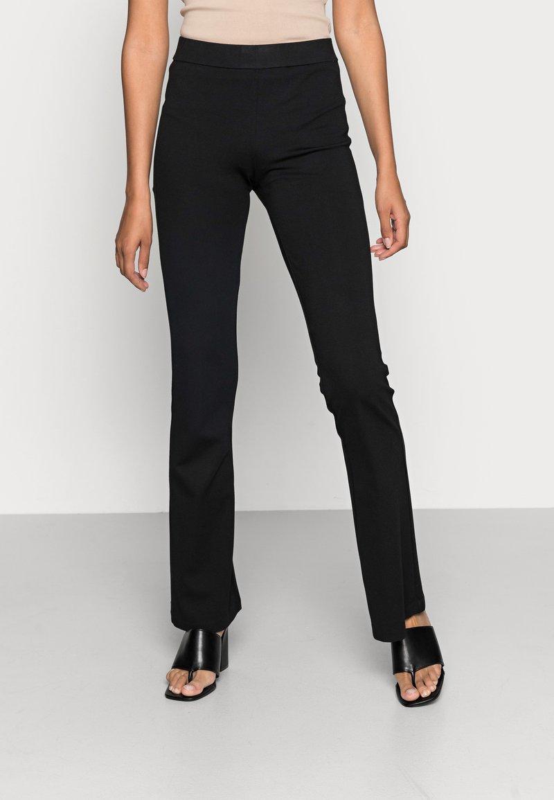 Vero Moda - VMKAMMA FLARED PANT - Trousers - black