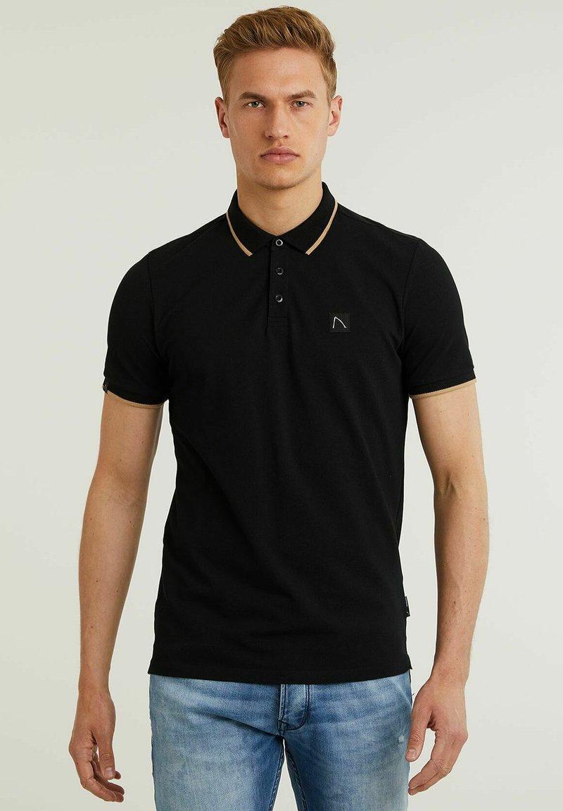 CHASIN' - Polo shirt - black